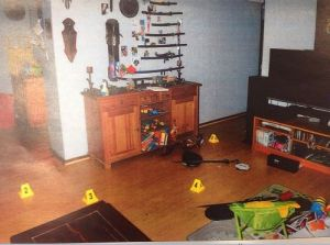 One of the many crime scene photos taken from inside the home. This shows swords on the wall and kids toys on the floor.
