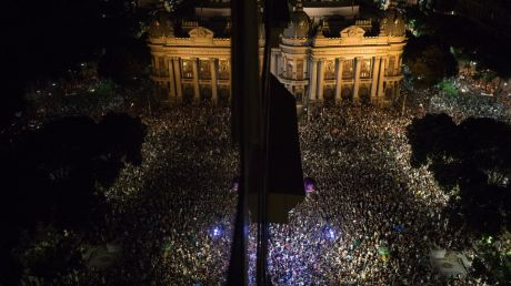 Thousands gather in front the Municipal Theater in downtown Rio de Janeiro, during a protest against the assassination ...