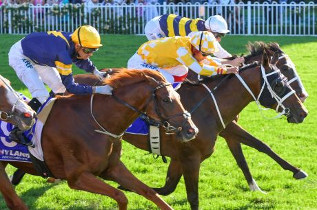 Jockey Michael Walker rides Comin' Through (centre) to win race 8, the Hyland Race Colours Ajax Stakes, during Chandon S ...