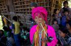 FILE - In this Dec. 18, 2013, file photo, an ethnic Chin women of Muun sub-tribe with traditional tattooed face smokes a ...