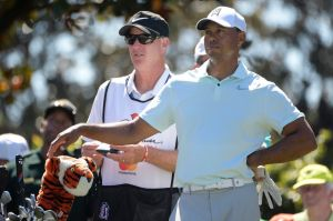 Cup of tea: Tiger Woods eased himself to a chance at a first title since 2013 with a third-round 69.