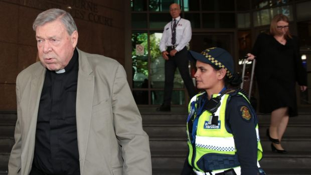 Cardinal Pell leaves court on Monday.