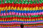 A worker attaches a name tag of a Buddhist who made donation to a lantern for the upcoming celebration of Buddha's ...