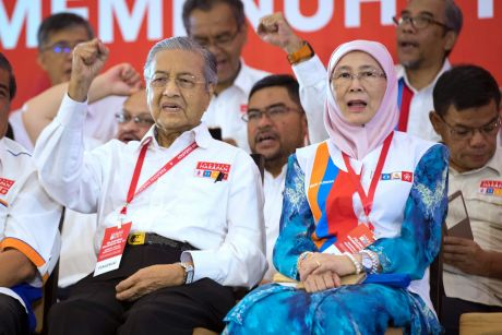 Malaysia's former Prime Minister Mahathir Mohamad, left, and Wan Azizah, wife of former Deputy Prime Minister Anwar ...