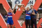 Western Bulldogs Ellie Blackburn, Katie Brennan and Paul Groves celebrate after the Bulldogs win the AFLW Grand Final ...