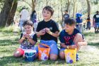 Alexander Nagaiya, 3, Aiden Nagaiya, 9, and Thomas Nagaiya, 9, eating their chocolates.