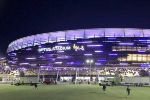 Optus Stadium in Perth turns purple after the Fremantle Dockers recorded the first AFL victory for a WA team at the new ...