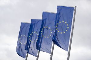 The stars of the European Union (EU) sit on banners flying outside the European Central Bank (ECB) headquarters.