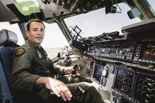 RAAF Flying Office Conor O'Neill at the controls in the huge C17A Globemaster at Canberra Airport open day.