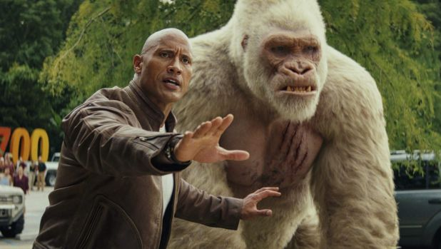 Dwayne Johnson as Davis Okoye and Jason Liles as George in Rampage.