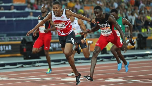 Zharnel Hughes, left, and Jereem Richards cross the line in the 200m final.