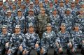 Chinese President Xi Jinping poses with soldiers on a navy ship after he reviewed the Chinese People's Liberation Army ...