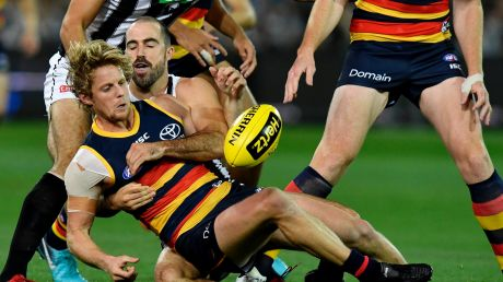 Magpie Steele Sidebottom tackles Rory Sloane.