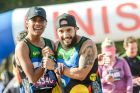 Runners from the Indigenous Marathon Foundation celebrate crossing the finish line.