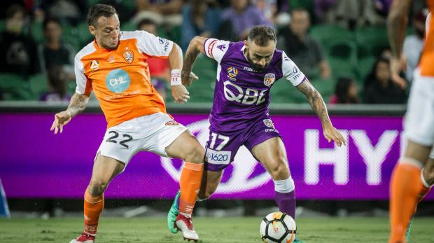 Eric Bautheac of the Brisbane Roar and Diego Castro of the Perth Glory during the Round 27 A-League match between the ...
