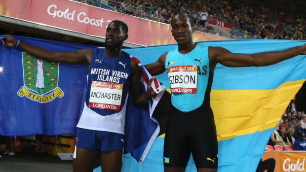 Kyron Mcmaster of the British Virgin Islands, left, and the Bahamas' Jeffery Gibson celebrate their gold and silver ...