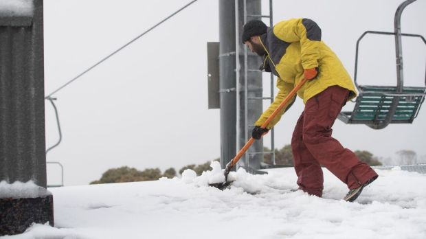 Snow is shovelled at Thredbo after a 5cm fall at the weekend.