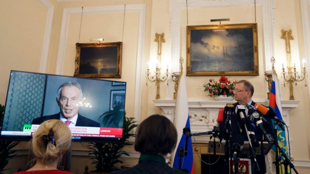 Russian Ambassador Alexander Yakovenko looks towards a screen showing former British Prime Minister Tony Blair, as he ...