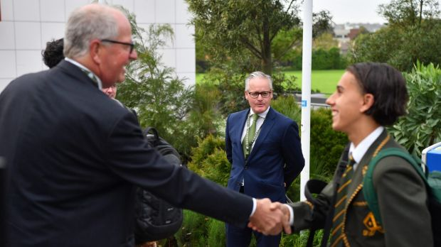 Trinity Grammar head master Dr Michael Davies (centre) with  deputy principal Rohan Brown (left) greeting students on ...