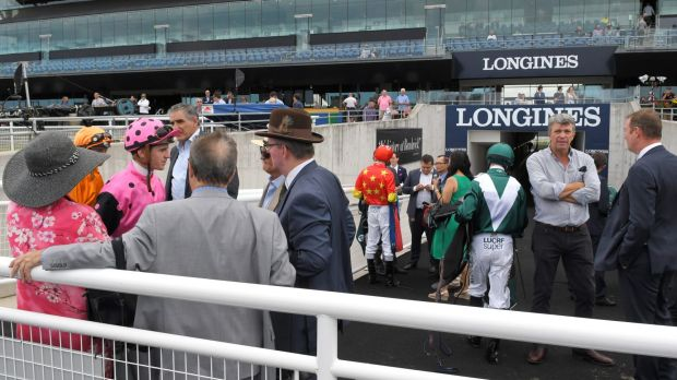 Jockeys gather with owners and trainers at Royal Randwick after the re-opening of the Kensington track.