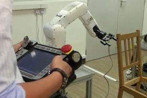 Researchers at Singapore's Nanyang Technological University program the robot.