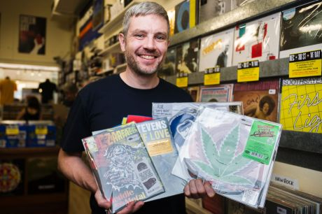 Landspeed Records owner Blake Budak holds some of the limited release records his store will have on sale for Record ...