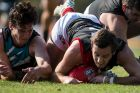 AFL Canberra Belconnen Magpies Vs Ainslie Tricolours 2018. Ainslie's Max Richardson scrambles for the ball. Photo: Dion ...