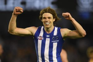 Gun forward:  North Melbourne's Ben Brown celebrates after booting a goal against Hawthorn.