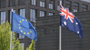 The Australian flag and the flag of the European Union are seen during an event at the German Ministry of Defence in Berlin.