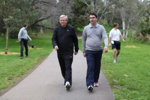 Prime Minister Kevin Rudd walks with adviser Patrick Gorman during an early morning walk in Adelaide.