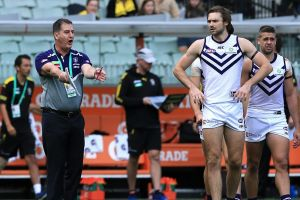 Full blast: Fremantle coach Ross Lyon gives his players some words of encouragement at quarter time against Richmond.