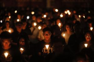 Tens of thousands of people attend an annual candlelight vigil at Hong Kong's Victoria Park. Hong Kongers commemorate ...