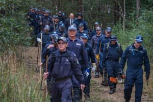 Police returning after their first day of a large-scale forensic search in bushlands, Kendall. as part of ongoing ...