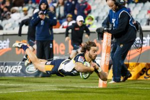Brumbies' Andy Muirhead scores a try to secure a 24-12 victory over the Hurricanes and snap a two-year Kiwi drought. g