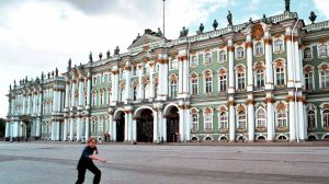 A boy skates in front of the Winter Palace in St. Petersburg, Russia. The Hermitage has a collection of nearly 3 million ...