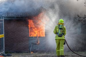 ACT Fire and Rescue set the house at 32 Kneeshaw street in Monash on fire as a training and assessment exercise. Photo ...