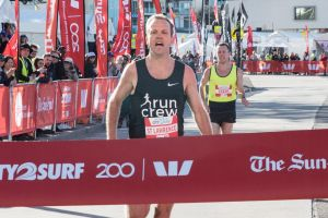 2018 CITY TO SURF: Ben St Lawrence is the first male competitor to cross the finish line of 2018 City to Surf with Liam ...