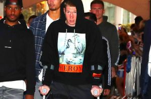 Sidelined: An injured Kevin De Bruyne arrives for the premiere of a documentary on Manchester City.