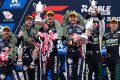 Three-up for Triple Eight: Jamie Whincup and Paul Dumbrell (centre), second-placed Shane van Gisbergen and co-driver ...