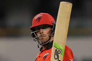 Cruising: Jake Lehmann of South Australia raises his bat  after scoring a half-century against NSW.
