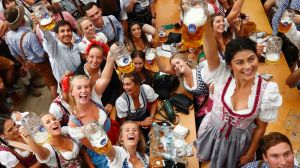 Young women lift glasses of beer during the opening of the 185th 'Oktoberfest' beer festival in Munich, Germany, ...