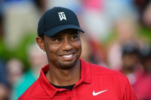 Tiger Woods stands on the 18th green after winning the Tour Championship golf tournament Sunday, Sept. 23, 2018, in ...