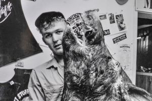 Apprentice taxidermist David Golden, 23, with an almost completed boars head. 1991.