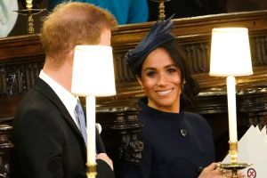 Prince Harry and Meghan, Duchess of Sussex take their seats ahead of the wedding of Princess Eugenie of York and Jack ...