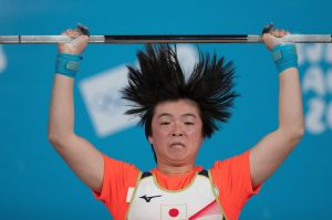 In this photo provided by the OIS/IOC, Japan's Sumire Hashimoto cleans and jerks in the Women's 63kg Weightlifting Group ...