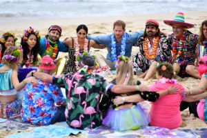Britain's Prince Harry and Meghan, Duchess of Sussex meet a local surfing community group, known as OneWave, raising ...
