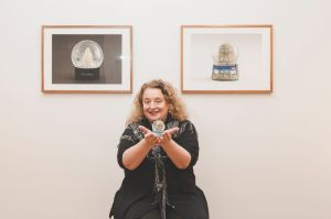 All shook up: Sally Hopman with some of her snow domes in the new exhibition.