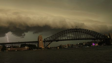 A lightning bolt strikes as a storm cell is seen above the Sydney Harbour Bridge on Saturday