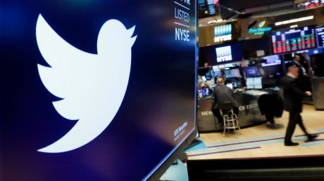 FILE - In this Feb. 8, 2018, file photo, the logo for Twitter is displayed above a trading post on the floor of the New ...