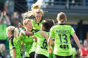 Ellie Carpenter is mobbed by teammates after scoring Canberra United's second goal. Photo: Sitthixay Ditthavong